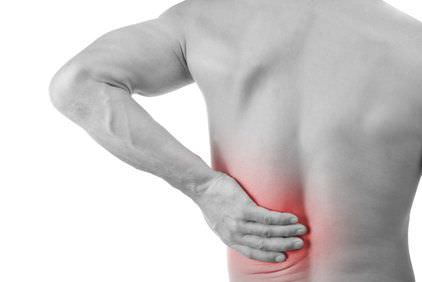 Man holding lower back pain