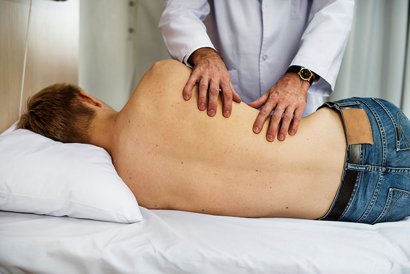 Person receiving chiropractic treatment