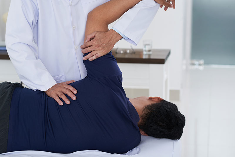 Chiropractor adjusting spine